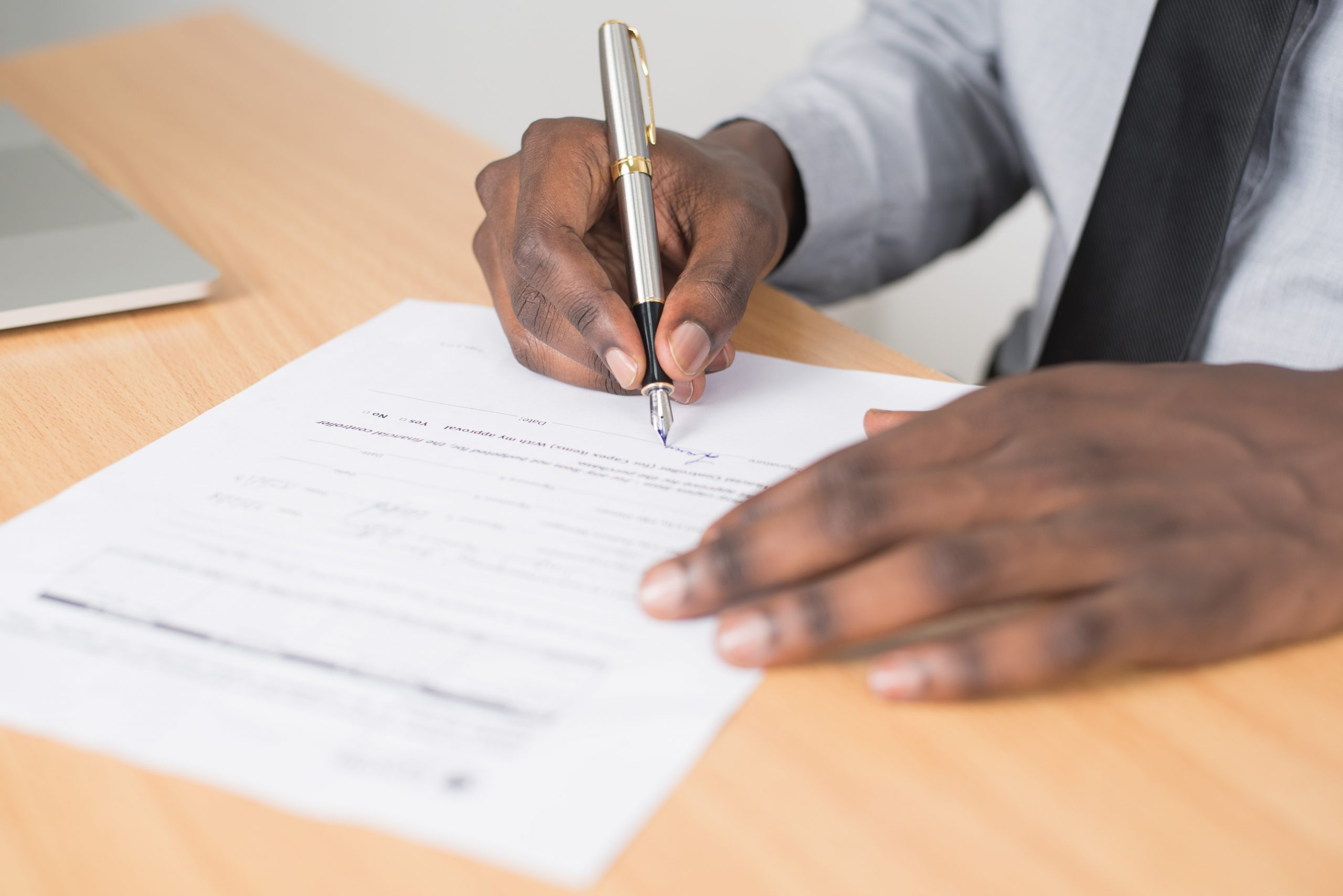 Person filling out insurance form